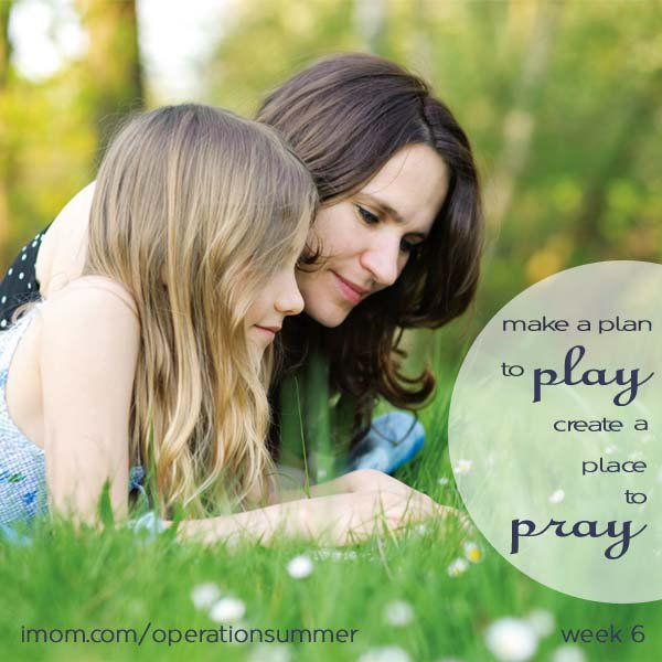 Mom and daughter praying together outside.